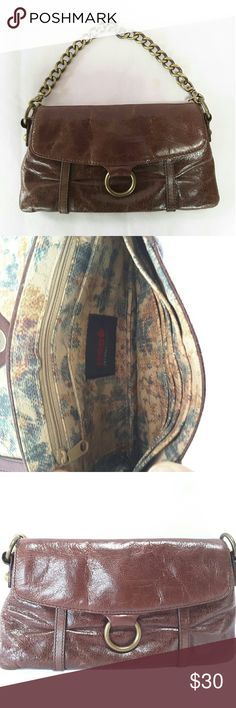 Hobo International handbag clutch Hobo International brown leather clutch with six credit card slots, two multifunctional slip pockets and one zipper pocket. Flap closured with magnet snap button.   Condition  The outer leather is slightly worn, lining is in great condition and clean.   Pets and smoke free home. HOBO Bags Clutches & Wristlets