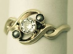 A very good antique pearl and 0.35 ct diamond, 18 ct yellow gold dress ring in the Art Nouveau style; part of the antique jewellery / estate jewelry collections at AC Silver  http://www.acsilver.co.uk/shop/pc/0-35-ct-Diamond-and-Seed-Pearl-Yellow-Gold-Dress-Ring-Art-Nouveau-Antique-Circa-1910-171p4079.htm