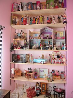 The top has Barbie vintage reproduction dolls, then my favorite dolls from around the world, then a fashion boutique and dream house. Barbie Doll House, Barbie I, Barbie Dream, Barbie Organization, Miniture Dollhouse, Doll Storage, Tall Shelves, Collection Displays, Doll House Plans