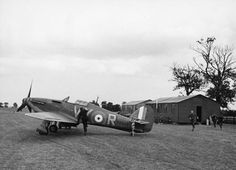 Pilot Officer Albert Gerald Lewis running to a Hurricane of 85 Squadron at Castle-Camps, July 1940.