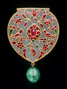 Pendant  --  Circa 1610-20  --  White nephrite jade set with rubies  emeralds in gold  --   Agra, India