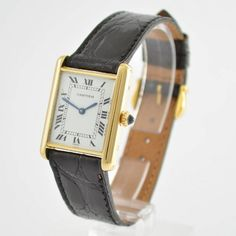 CARTIER Paris wristwatch series Tank, manual winding, Switzerland around 1998, massiv 18k yellow gold including leather strap with gold-plated original buckle, case back at the sides 4-times screwed-down, jeweled crown, enamel coloured dial hairlines, calibre ETA 2512-1, for Cartier calibre 78-1, 17 jewels, incablock shock-absorber, mineral glass, measures approx. 30 x 24 mm, condition 2-3