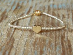 Tiny Delicate Silver & Single Gold Heart Friendship by minniegrace, $10.00