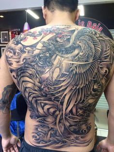 The full back tattoo of Phoenix and tiger (took about 28 hours). Drawing and inking by artist Kob