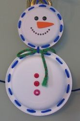 Kindergarten Winter Activities: Lace a Paper Plate Snowman. Writing in the stomach?