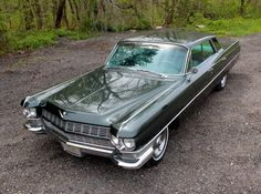 1964 Cadillac DeVille - I learned to drive in my Dad's blue caddy. It was like driving a barge!