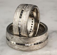 Black and white diamonds in mokume wedding rings