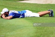 Caddie of Danny Willett of Team Europe lines up on the 17th green during the final day's singles matches at the EurAsia Cup presented by DRB-HICOM at Glenmarie G&CC on January 17, 2016 in Kuala Lumpur, Malaysia..