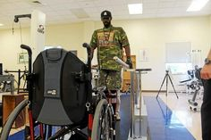 """Paralyzed by a bullet, New Haven man determined to walk again. New Haven Register, Sept. 13, 2014. """"Yancey Horton on his feet during a rehab session at Gaylord Hospital. Horton was shot in 2004 during an attempted robbery which left him paralyzed."""""""