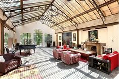 This ornate factory-loft-turned-home in Paris was already pretty spectacular, but the fact that its gabled glass roof rests on a early 20th-century steel structure created by famed French architect...