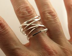 The twisted silver ring is simple and modern. Silver wire is hammered and then twisted, so your silver tornado ring will be a one of a kind. This is a great everyday ring or a for a night out too! This stacked silver ring looks like multiple rings, but is just one fun silver ring.