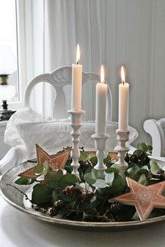 Glowing candles, stenciled stars & fresh greenery in a simple holiday display. English Christmas, Noel Christmas, Christmas Candles, Christmas And New Year, Simple Christmas, All Things Christmas, White Christmas, Christmas Crafts, Christmas Decorations