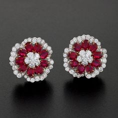 Van Cleef & Arpels Camellia Platinum, Diamond and Ruby Ear Clips.