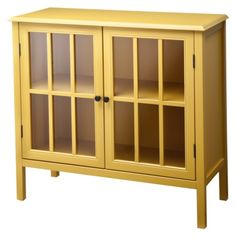 Yellow bookcase with glass