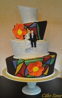 tilted wedding cake with mosaic design