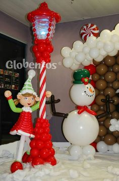 Christmas scene with street lamp, elf and snowman, all made from balloons. ☃