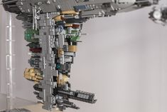Professional LEGO builder mortesv built the EF76 Nebulon-B frigate, the well-known Rebel medican ship seen in Star Wars films.  The ship is 980 feet long, so the LEGO model had to be huge, with its structuere carefully revised to get the details and proportions as accurate as possible.  Below, you can check out photos of the frigate (via Eurobricks Forums) from different angles with a mini Falcon. The details look impressively intricate. You can see cool sections with antenna arrays,