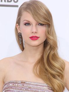 Old Hollywood ~ Finger waves and a soft side part give Taylor Swift's strands a vintage vixen upgrade.