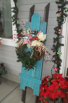 Winter Sleigh for my front porch! Makes me smile...and wish we had some snow.