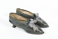 A pair of midnight blue morocco leather women's shoes, circa 1785. trimmed with navy ribbons, low 'Italian' heel, 24cm, 9 1/2in long (2) Provenance: The late Harry Matthews collection