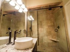 A gorgeous 3 piece bathroom with Granite counters & a Travertine stone shower. Photo by Digital Video Listings.