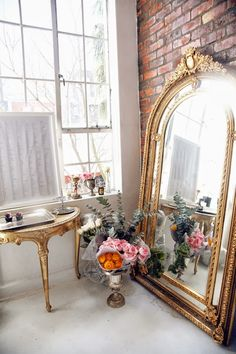 everything. vintage mirror, gold trim, exposed brick, huge window, white everything, natural light, flowers.....