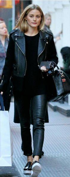 Who made Olivia Palermo's black leather pants, white platform shoes, and handbag?
