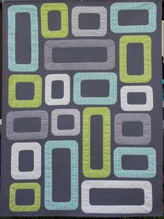 Cinder Blocks Quilt - it would be fun to highlight fussy-cut feature fabrics inside each cinder block. This one is a baby quilt but this would be awesome in a larger size as well.