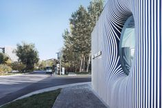 Wutopia Lab wraps Striped House visitor centre with wall inspired by nautical shirts