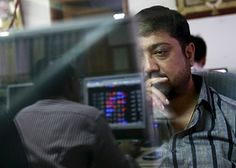 A broker reacts while trading at his computer terminal at a stock brokerage firm in Mumbai, India, August 24, 2015. India's benchmark BSE index fell more than 5 percent on Monday to their lowest in a year, as a rout in Chinese equities sparked widespread unrest in global financial markets. REUTERS/Danish Siddiqui