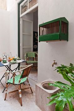 A patio in a first floor apartment.
