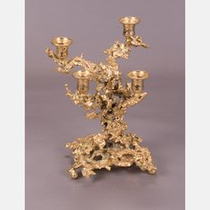 LOT 144 CLAUDE VICTOR BOELTZ  (French, b. 1937) - Candelabra, Medium: Gilt bronze, Dimensions: H: 12 W: 11 D: 10 Est: $200-400  Description (French, b. 1937) - Candelabra, Condition Lacking crystals. Signature Signed on base.