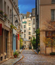 """A Parisian Alley""."