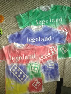 Legoland lego t-shirts- Front  Steps:  Need white t-shirts, spray fabric paint, letter stickers (scrapbooking area), and cardboard  1. Place piece of cardboard between 2 layers of fabric in shirt  2. Place letter stickers on shirt  3. Cut out strips of cardboard and tape together to make various sizes of rectangles  3. Lay rectangles on shirt - no need to tape or stick onto shirt in any way  4. I used kid's circle stickers to make the circles- attach these.   5. Spray each area a different…