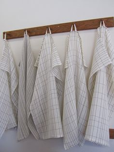 Linen Towels.  Plain weave, 2/40 natural linen for warp and weft.  Handwoven hanging tabs.