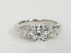 Striking and elegant, this 3-stone diamond ring is crafted in platinum