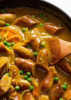 The ultimate retro sausage recipe – Curried Sausages! Browned sausages in a curry flavoured sausage gravy with carrots and peas, it's totall. Sausage Recipes, Pork Recipes, Cooking Recipes, Curry Recipes, Paleo Recipes, Recipies, Mince Recipes, Family Recipes, Delicious Recipes