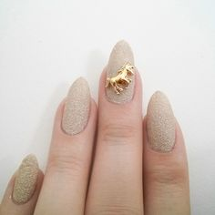 Sparkly nude unicorn nails
