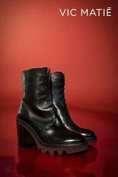 VIC MATIE' | Black boots with burgundy sole