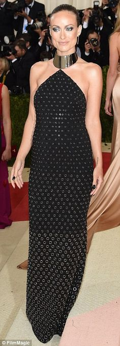 Dresssed to the nines: The starlet looked incredible in a black and gold Michael Kors dres...