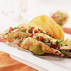 hard-shell chicken and kiwi tacos.......In a small bowl combine kiwi, tomato, and lemon juice; set aside.