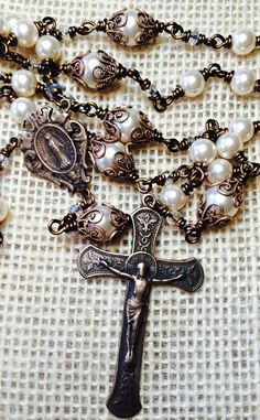 Hand wire wrapped rosary with Swarovski Pearl beads, Miraculous Medal and Immaculate Crucifix by Et Corde Rosaries & Jewelry Catholic Jewelry, Rosary Catholic, Rosary Beads, Prayer Beads, Holy Rosary, Triangle Necklace, Pearl Cream, Christian Jewelry, Moon Necklace
