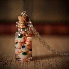 Could make this with a mini-jar & make the eyes out of sculpt clay. Could even pour resin inside to give the look of eyes. Jar of Eyes Bottle Necklace by AlternateHistory on Etsy