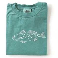 For our fishing enthusiast! This simple speckled trout design is hand screened in white on a Comfort Colors light green, long sleeve t-shirt. This shirt is pre-shrunk, 100% cotton, 5.4-ounce children'