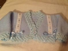"""""""Maria"""" - This type of short baby jacket is called a Rebeca. Lace edging on all borders, entredeux and tiny bows. ~ Canastilla en Lana by Esperanza Rodriguez Fernandez"""