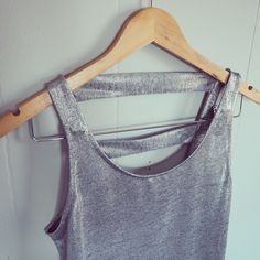 Shinny silver tank top Shinny silver tank top with detailed back. Excellent condition. Charlotte Russe Tops Tank Tops