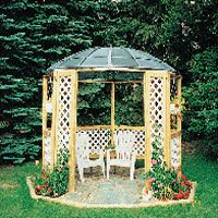 Easy DIY Gazebo.  Old satellite dish for a roof, some 2X4's and lattice.