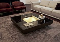 Modern Desgin | Black coffee table design with a stunning center lighting | #coffeetable #moderndesign#livingroom the living room, modern living room, contemporary design | Visit our blog www.coffeeandsidetables.com