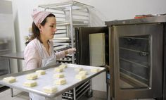 Nicole Campbell, of Durham and part of Crepe Crusaders Cafe takes biscuits out of the oven in the Artisan Kitchen that is located in Warm Sugar Bakery in Hellertown. Artisan Kitchen, Crusaders, Durham, Biscuits, Bakery, Oven, Sweet Home, Sugar, Warm