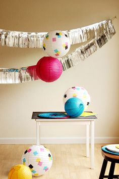 Decorate white lanterns with tissue paper squares.